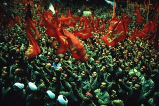 Thousands of Iranian Basiji (mobilised volunteer forces) hold religious banners and chant anti-US slogans, at a rally before their departure for the front, Shiroudi Stadium, Tehran, 4 February 1986