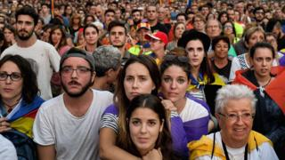 Image shows Pro-independence supporters reacting to Carles Puigdemont's speech in Barcelona