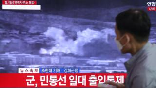 A person watches breaking news regarding the destruction of the inter-Korean liaison office in Kaesong