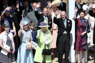 The Queen, Duke of Edinburgh and other members of the Royal Family wave after the wedding