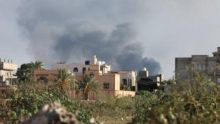 Smoke rises during heavy clashes between rival factions in Libya's Tripoli, 28 August 2018