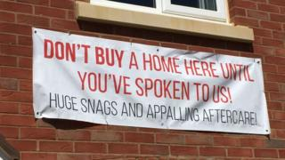 """Sign outside the home saying """"Don't but a home here until you've spoken to us! Huge snags and appalling aftercare"""""""