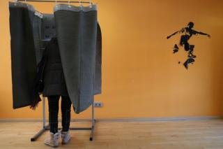 A woman votes during the general election in Madrid on 10 November 2019