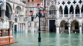 St Mark's Square in Venice, Italy, is covered in water during an exceptional high tide, 13 November 2019