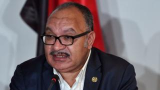 Papua New Guinea's Prime Minister Peter O'Neill speaks during the Asia-Pacific Economic Cooperation (APEC) Summit in Port Moresby in November 2018