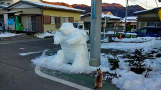 Instagram user kazu.sae's snow creation - a Pokemon Kamex character in a car park.
