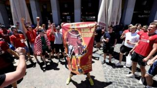 Liverpool supporters carry a poster of player Virgil Van Dijk as they enjoy Madrid, ahead of the Champions League final