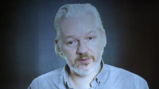 Julian Assange on a videolink