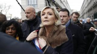 National Front leader Marine Le Pen (centre) at a protest march in Paris, France. Photo: 28 March 2018