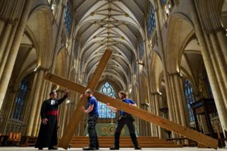 in_pictures Members of the Minster's Works Department erect the Lent Cross at York Minster, 24 February 2020.