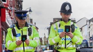 Cumbria Police officers with smartphones