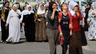 Women mourn during a funeral ceremony for three Turkish Kurdish men, who were killed during clashes between security forces and PKK on Friday, in the south-eastern town of Silopi in Sirnak province, Turkey, 8 August 2015
