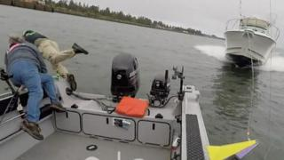 Watch how fishermen in Oregon react as a boat speeds straight towards them.