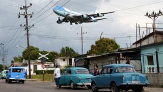 "Air Force One carrying U.S. President Barack Obama and his family flies over a neighbourhood of Havana as it approaches the runway to land at Havana""s international airport, March 20, 2016."