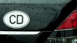 "Car plates reading ""CD"""