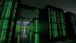 """This picture taken on June 16, 2020 shows Japan""""s Fugaku supercomputer at the Riken Center for Computational Science in Kobe,"""