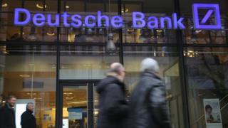People walk past a branch of Deutsche Bank on January 17, 2014 in Berlin, Germany.