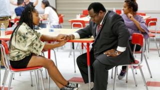 """Tyra Hemans, a senior from Marjory Stoneman Douglas High School, speaks with Florida Rep. Wengay """"Newt"""" Newton, (D-St. Petersburg), during a meeting at Leon High School after the students arrived in Tallahassee, Florida, US on 20 February 2018."""