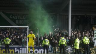Flares were thrown during a match between Stranraer and Celtic