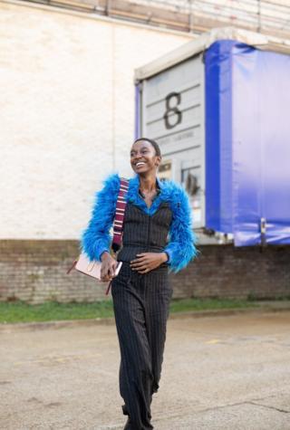 Model in a fluffy blue coat