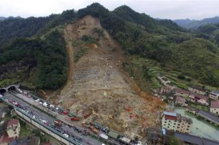 A aerial view shows rescuers searching for survivors among debris at the site of a landslide in Yaxi township of Lishui, Zhejiang province
