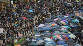 Protesters take part in a demonstration against what activists say is police violence in Hong Kong on July 28, 2019