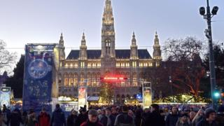 Tourists and citizens take part in New Year eve celebrations in Vienna, on December 31, 2016