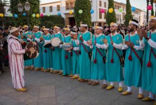 Ahwach musicians perform and celebrate with members of the community on the eve of the 2969th Amazigh New Year near the parliament in the capital of Rabat, Morocco, 12 January 2019. After more than eight years of devoting Berbers as an official language alongside Arabic, voices in Morocco are increasingly calling for a public holiday to celebrate the Berber New Year.