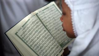 Куран кармаган кыз