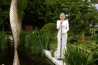 Jazz singer Natalie Rushdie as the Lady of the Lake in the Savills and David Huber Garden, designed by Andrew Duff