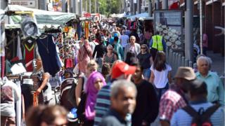 People walk through Walthamstow market