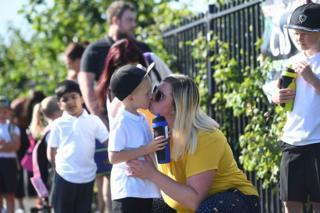 Parents drop off children at Queen's Hill Primary School in Norfolk
