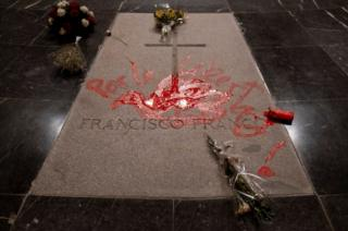 "A picture of Franco's tomb with a red dove daubed and the slogan ""For Freedom"" daubed on it in red paint"
