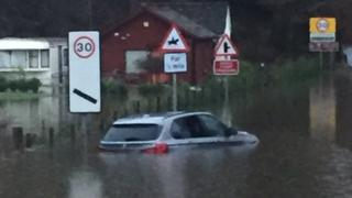 Car trapped in flood