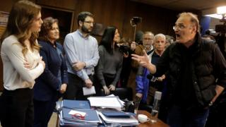 Protesters from the Communist-affiliated trade union PAME argue with Greek Labour Minister Effie Achtsioglou (L), 9 Jan 18
