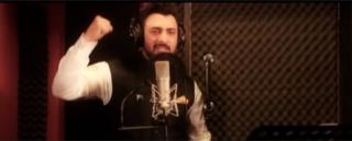 A singer raises his fist in the music video for the Kashmir Anthem Song