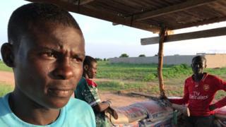 Nigerian vigilantes at a roadblock