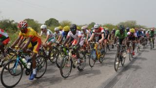Cyclists compete during the first stage of the 29th International Cycling Tour of Burkina Faso (Tour du Faso) between Ouagadougou and Koupela on October 28, 2016.