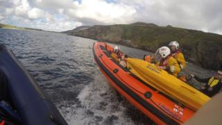The sheep was comforted by RNLI crew after her 200ft fall