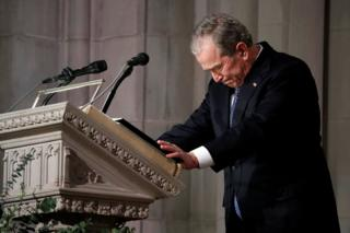 Former President George W Bush speaks at the state funeral for his father, former President George HW Bush