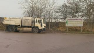 A lorry and a sign for the John Wade Group site
