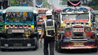 Jeepneys on a busy street in Manila