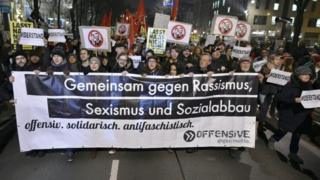 """Protesters hold a banner reading """"Together against racism, sexism and social cuts"""" during a demonstration against Vienna's Academics Ball. Photo: 26 January 2018"""