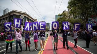 San Francisco Gay Pride Parade marchers protest Facebook not allowing transgender people from choosing their own name, rather than birth name on the social networking site, June 28, 2015 in San Francisco,