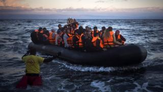 Refugees and migrants arrive on a dinghy from the Turkish coast to the Greek island of Lesbos. 18 Dec 2015
