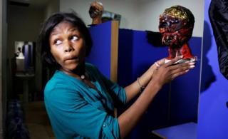 Special effects artist Abioye Balogun, 23, holds a piece of her work for a Halloween film project in her art studio in Victoria Island, Lagos, Nigeria October 28, 2016