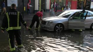 Vehicles became trapped in floodwaters in North Harrow, north-west London