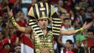 "Football fans for Egypt dey ginger dem national team as dem beat Uganda 1-0 for Tuesday World Cup 2018 qualifier. Midfielder Sam Morsy say di Pharoahs don move ""one step closer"" to play for their first World Cup since 1990 with di win."