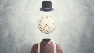 Concept image - surreal man with a clock as his head