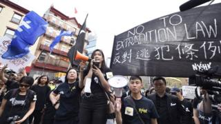 Frances Hui speaks at a Unusual York rally in give a enhance to of Hong Kong protesters